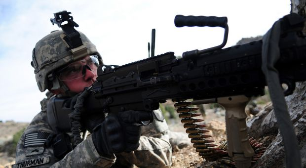 U.S. Army Sgt. Joshua Thurman of Alpha Troop, 1st Squadron, 33rd Cavalry Regiment, 3rd Brigade, 101st Airborne Divison, provides security while on patrol in Spera, Khowst province, Afghanistan, March 11