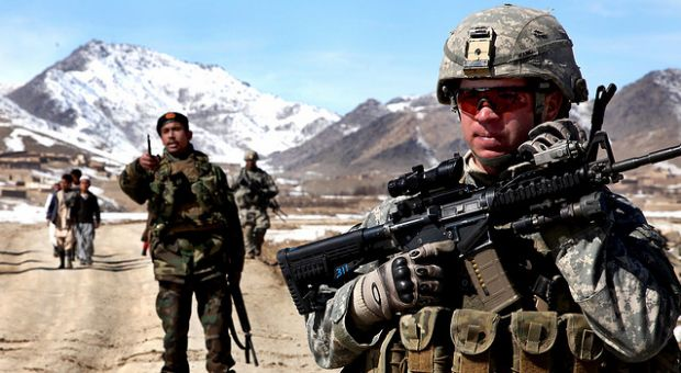 A U.S. Army Soldier patrols with Afghan soldiers to check on conditions in the village of Yawez in Wardak province, Afghanistan, Feb. 17, 2010