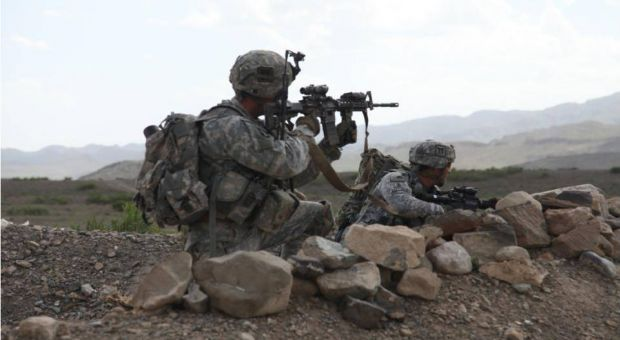 U.S. Army Sgt. Maj. Mark Bartosch and Staff Sgt. Bradley Watts pull security on the outskirts of the village of Margah, during a presence patrol. Sgt. Maj. Bartosch is the Operations Sgt. Maj. for the 187th Infantry and Staff Sgt. Watts is a member of 4th Platoon, ABU Company, 1-187th Infantry (Air Assault), Combat Outpost Margah, Paktika Province, Afghanistan, 6 May 2010.