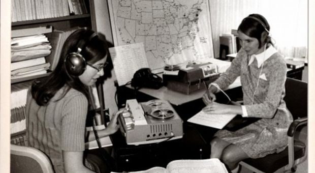 Beth Witherell and Jennifer Ellsworth, graduate students who worked on DARE, listen to one of the more than 1,800 audio recordings made in the field. Their job was to transcribe pronunciations in phonetics and select parts of conversations for examples of words to include in DARE.