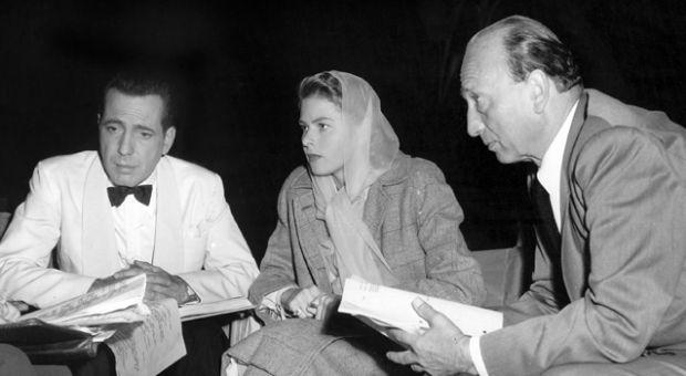 "Humphrey Bogart, Ingrid Bergman, and Michael Curtiz on the set of ""Casablanca"" in 1947."