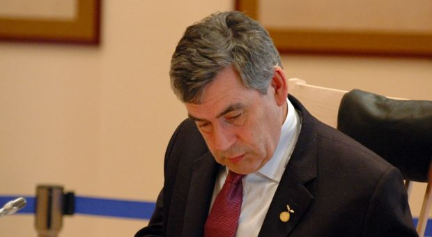 British Prime Minister Gordon Brown preparing notes before the 2008 G8 meeting