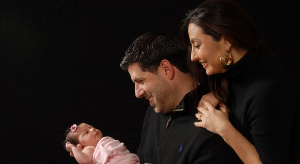 Father Albert Cutie with his wife and baby