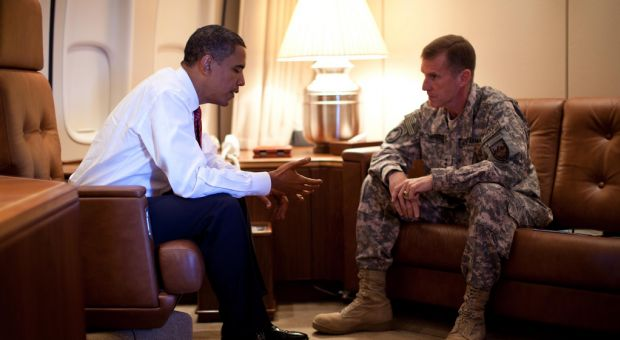 President Barack Obama meets with Army Gen. Stanley McChrystal, the Commander of U.S. Forces in Afghanistan, aboard Air Force One in Copenhagen, Denmark on Oct. 2, 2009.