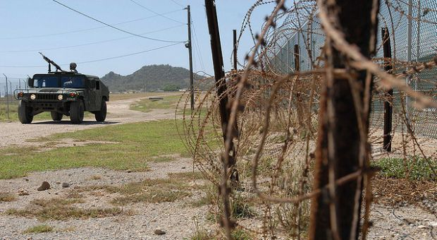 A Humvee from the Puerto Rico Army National Guard's, 480th Military Police Company, patrols the perimeter of the detention facility at Guantanamo Bay Naval Base, Cuba, Oct. 7, 2009