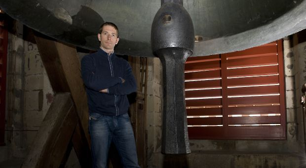 Author Richard Harvell next to a bell in the Church of St. Gall, Switzerland.