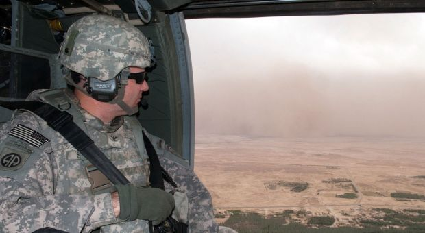 Col. Mark R. Stammer, commander of 1st Brigade, 82nd Airborne Division (Advise and Assist Brigade), watches a dust storm blow toward the Euphrates River and his UH-60 Black Hawk helicopter May 10, 2010