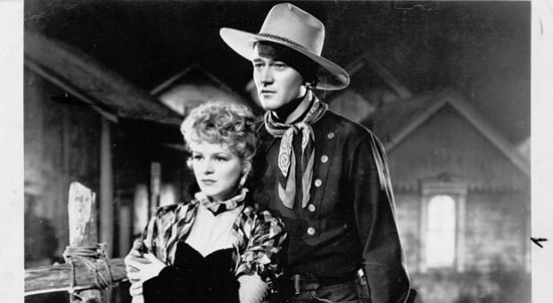 "John Wayne is pictured here in a still from ""Stagecoach"" with Claire Trevor."
