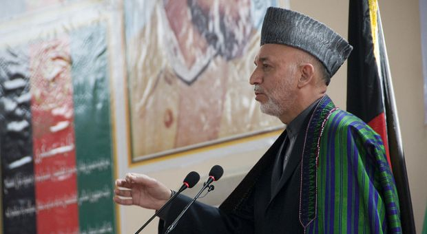 Afghan President Hamid Karzai gives a speech at the National Military Academy of Afghanistan, during the graduation ceremony for 212 new officers March 18, 2010