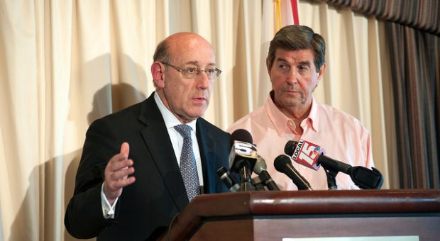 Governor Bob Riley and Kenneth Feinberg (black suit) discuss a quicker way to help disperse the allocated funds at a press conference at Cotton Creek Club in Gulf Shores, AL. 01 July 2010