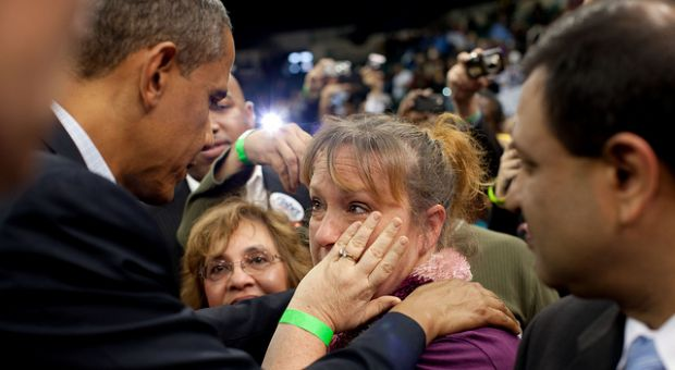 President Barack Obama greets a woman in the audience after speaking at Cleveland State University in Cleveland, Ohio, Oct. 31, 2010