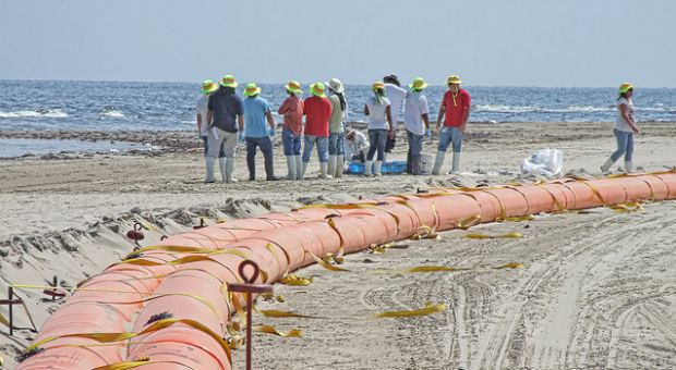 Oil containment boom on the beach at Grand Isle, Louisiana on June 10, 2010