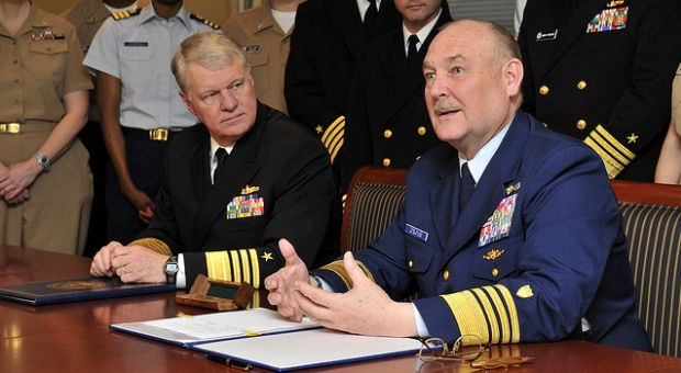 Chief of Naval Operations (CNO) Adm. Gary Roughead and Coast Guard Commandant Adm. Thad W. Allen sign a memorandum of agreement (MOA) for the Safe Harbor program at the Pentagon, April 2009